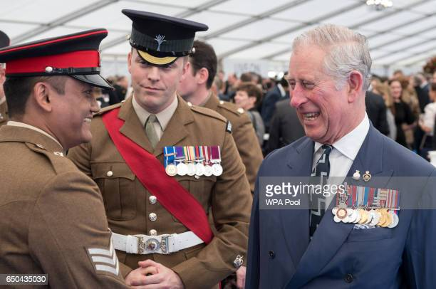 Prince Charles Prince of Wales speaks with British military personnel at a reception following the unveiling of the new memorial to members of the...