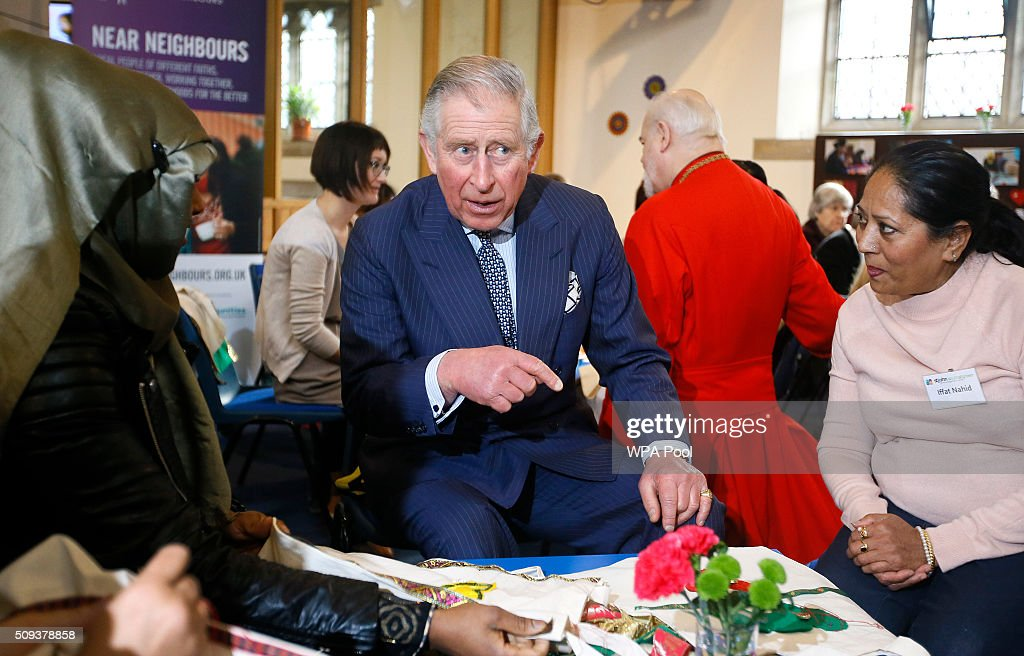 <a gi-track='captionPersonalityLinkClicked' href=/galleries/search?phrase=Prince+Charles&family=editorial&specificpeople=160180 ng-click='$event.stopPropagation()'>Prince Charles</a>, Prince of Wales speaks with Iffat Nahid, (R) during a creative language session at a visit to St John's Church on February 10, 2016 in Southall, England. The Prince met members of the congregation and heard about the church's inter-faith work and role in the local community.