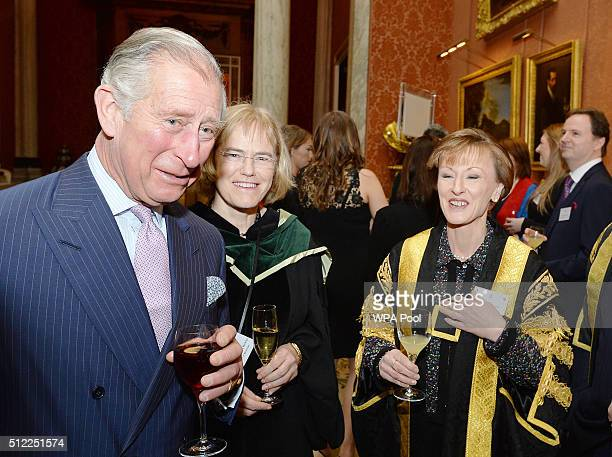 Prince Charles Prince of Wales speaks with staff from the University of Bradford at a reception after the presentation of The Queen's Anniversary...
