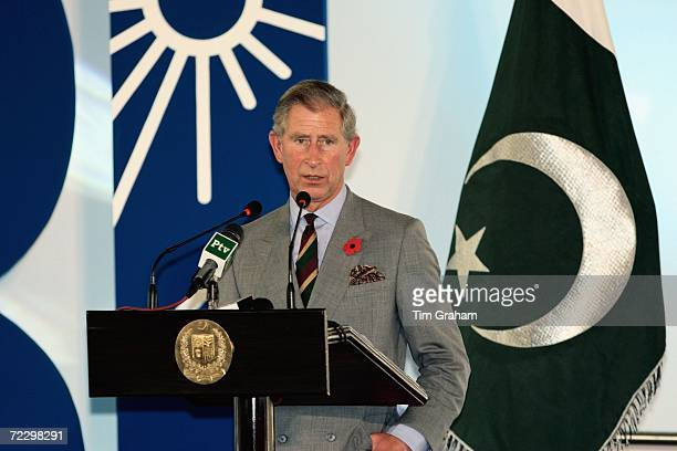 Prince Charles Prince of Wales stands besides a Pakistani flag and delivers a speech during a visit to the Prime Minister's Residence on October 30...