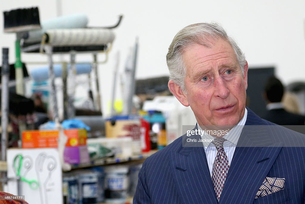 Prince Charles, Prince of Wales stands in front of brushes and paints as he speaks to set designers during an official visit to Essex and High House Production Park on January 29, 2014 in Purfleet, England. High House Production Park is a world-class centre for technical skills, crafts and artistic production and training, which is home to the Royal Opera House's Bob and Tamar Manoukian Production workshop, the National Skills Academys Backstage Centre and Acme High House Artists Studios.