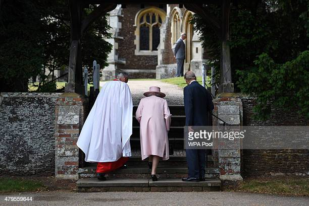 Prince Charles Prince of Wales stands in the distance as Queen Elizabeth II Prince Phillip Duke of Cambridge and Archbishop of Canterbury Justin...