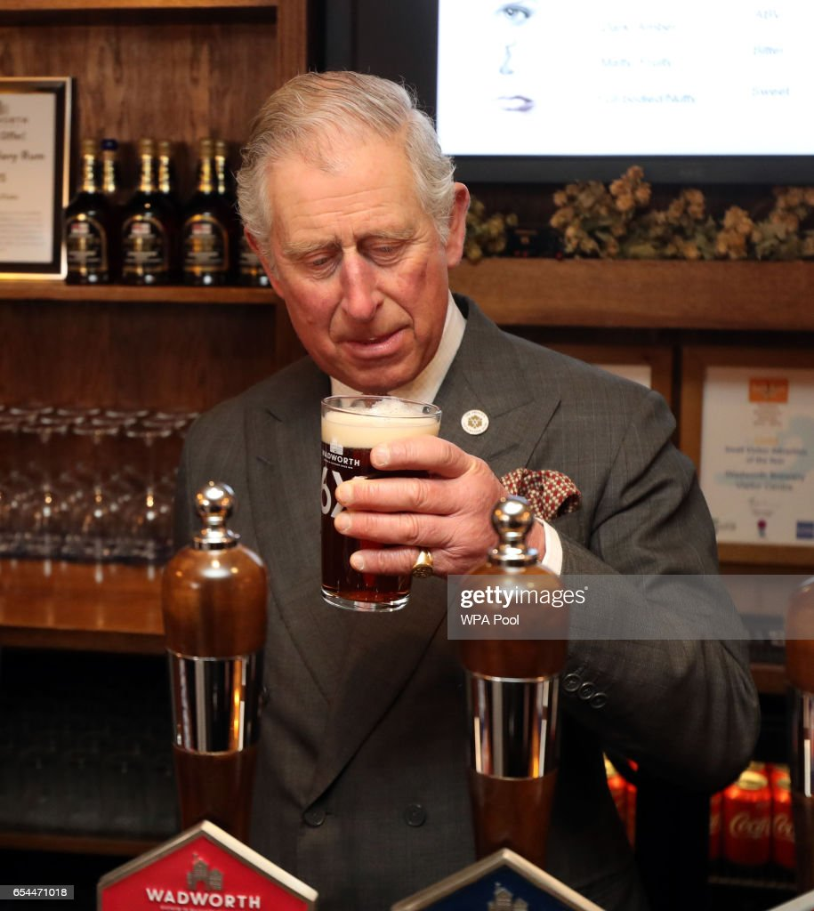 prince-charles-prince-of-wales-takes-a-drink-after-pouring-a-pint-of-picture-id654471018