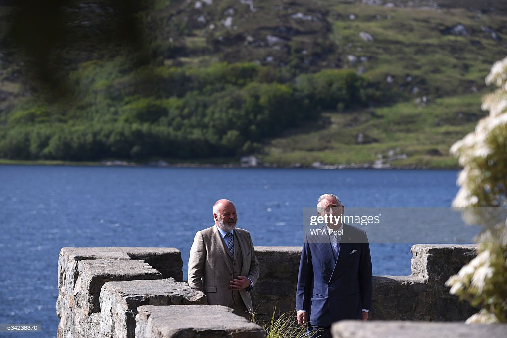 Prince Charles, Prince of Wales takes in the surroundings from the boathouse roof with their guide Mr Dave Duggan, Divisional Manager Parks and Wildlife Service (L) as they visited Glenveagh Castle on May 25, 2016 in Letterkenny, Ireland. The royal couple are on a one day visit to Ireland having spent two days across the border in Northern Ireland. It is their first trip to Donegal.