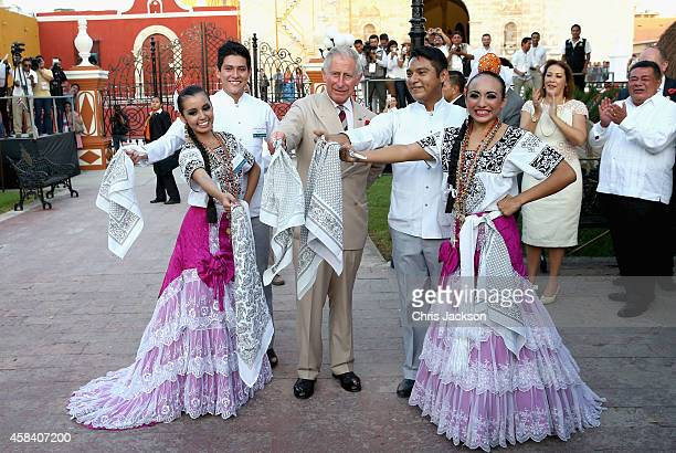Prince Charles Prince of Wales takes part in traditional Mexican clog dancing in Zocalo Square on November 4 2014 in Campeche Mexico The Royal Couple...
