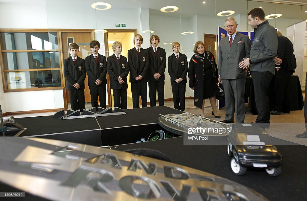 Prince Charles, Prince of Wales talks to pupils from Wilmslow High School during a visit the Jaguar Land Rover Education Centre on January 21, 2013 near Wilmslow, Merseyside, England. Prince Charles is carrying out a series of engagements in the North West to celebrate British manufacturing and engineering.
