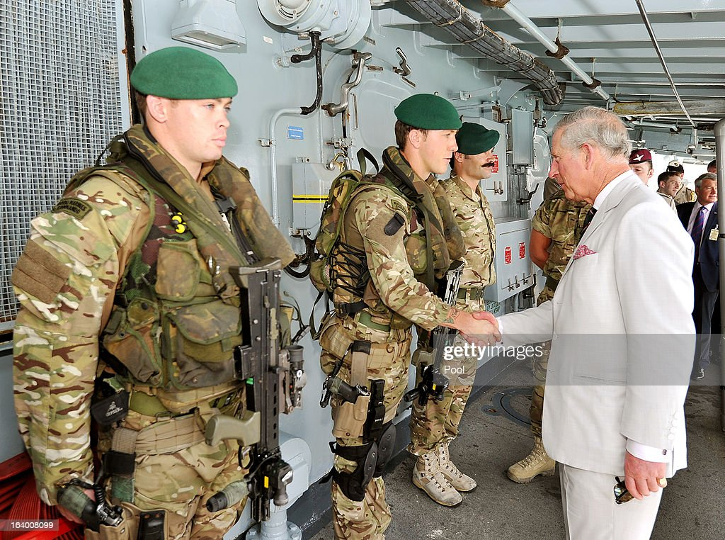 Prince Charles, Prince of Wales talks to Royal Marine Commandos aboard HMS Northumberland, who have been fighting pirates, gun and drug runners in the Indian Ocean, during a visit to the Type 23 Frigate, docked in the port on March 19, 2013 in Muscat, Oman. The Royal couple are on the fourth and final leg of a tour of the Middle East taking in Jordan, Qatar, Saudia Arabia and Oman.