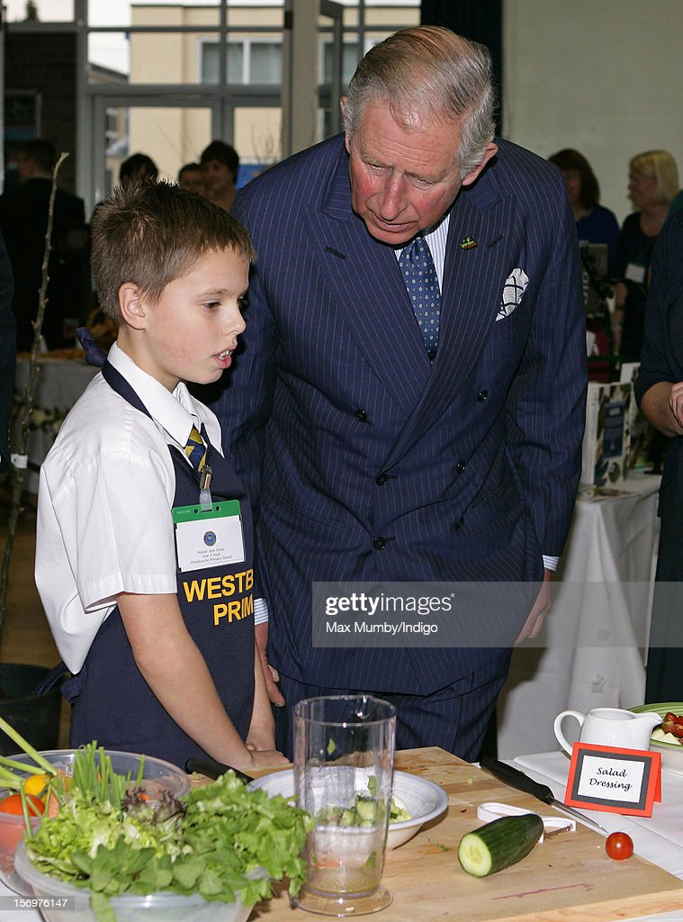 Prince Charles, Prince of Wales talks with a school boy doing a cookery demonstration as he, accompanied by Jamie Oliver, visits Carshalton Boys Sports College to see how the school has transformed its approach to healthy eating on November 26, 2012 in Carshalton, England.