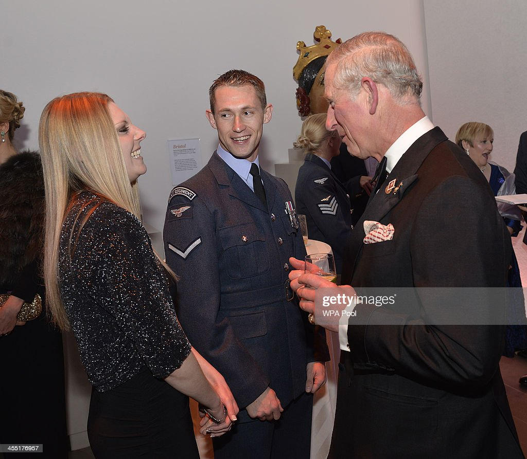 <a gi-track='captionPersonalityLinkClicked' href=/galleries/search?phrase=Prince+Charles&family=editorial&specificpeople=160180 ng-click='$event.stopPropagation()'>Prince Charles</a>, Prince of Wales talks with Lance Corporal <a gi-track='captionPersonalityLinkClicked' href=/galleries/search?phrase=Alex+Price&family=editorial&specificpeople=227052 ng-click='$event.stopPropagation()'>Alex Price</a> and partner Vicki Jones during The Sun Military Awards at National Maritime Museum on December 11, 2013 in London, England.