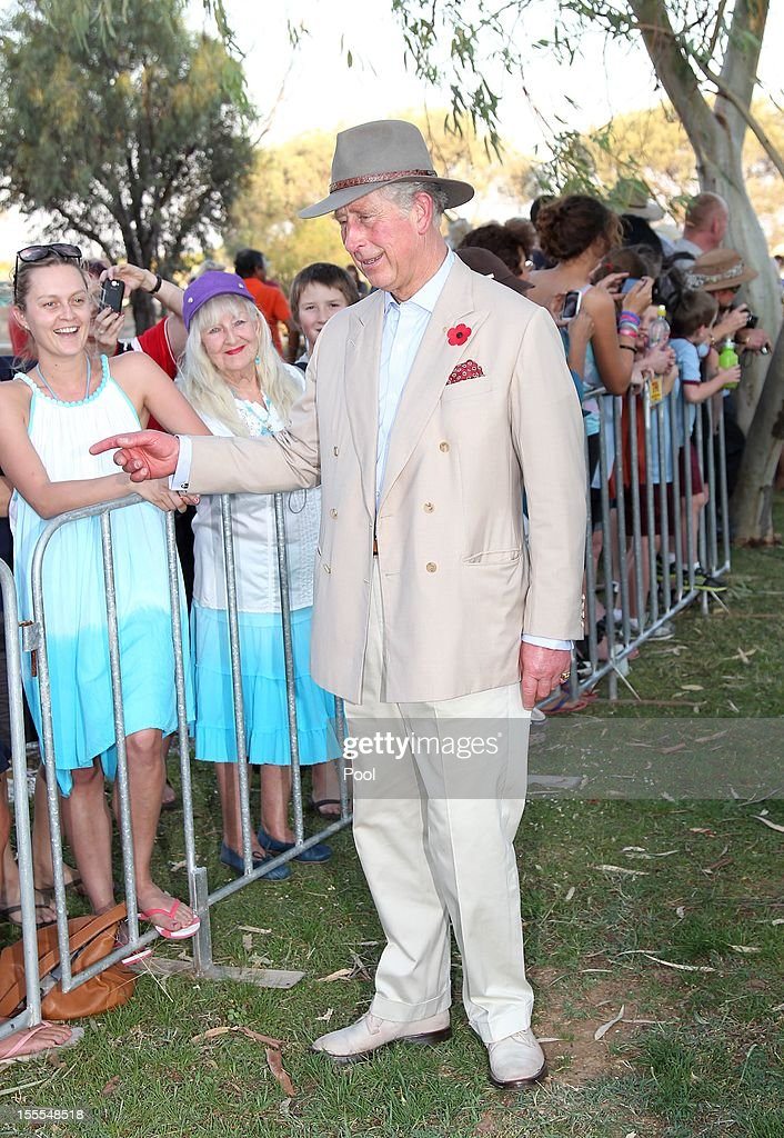 Prince Charles, Prince of Wales talks with locals after arriving in Longreach on November 05, 2012 in Longreach, Australia. The Royal couple are in Australia on the second leg of a Diamond Jubilee Tour taking in Papua New Guinea, Australia and New Zealand.