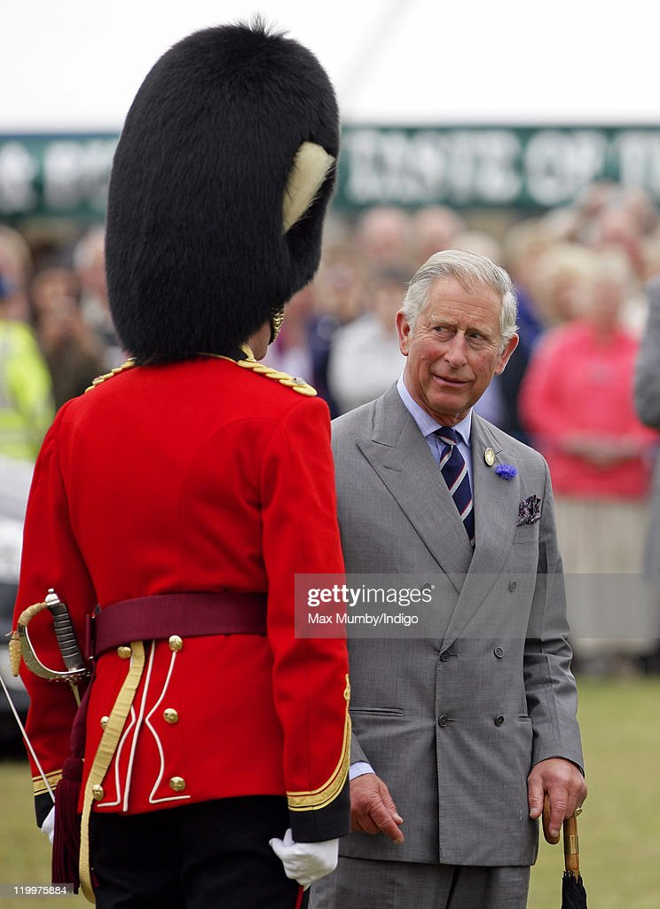 <a gi-track='captionPersonalityLinkClicked' href=/galleries/search?phrase=Prince+Charles+-+Prince+of+Wales&family=editorial&specificpeople=160180 ng-click='$event.stopPropagation()'>Prince Charles</a>, Prince of Wales talks with the conductor of a military band as he visits the 130th Sandringham Flower Show on July 27, 2011 in Huntingdon, England.