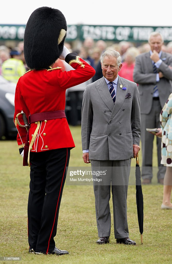 <a gi-track='captionPersonalityLinkClicked' href=/galleries/search?phrase=Prince+Charles+-+Prince+of+Wales&family=editorial&specificpeople=160180 ng-click='$event.stopPropagation()'>Prince Charles</a>, Prince of Wales talks with the conductor of the military band as he visits the 130th Sandringham Flower Show on July 27, 2011 in Huntingdon, England.