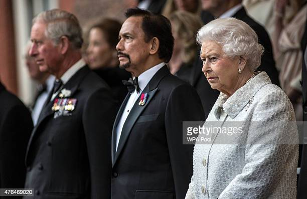 Prince Charles Prince of Wales the Sultan of Brunei and Queen Elizabeth II attend the Gurkha 200 pageant in the grounds of the Royal Hospital Chelsea...