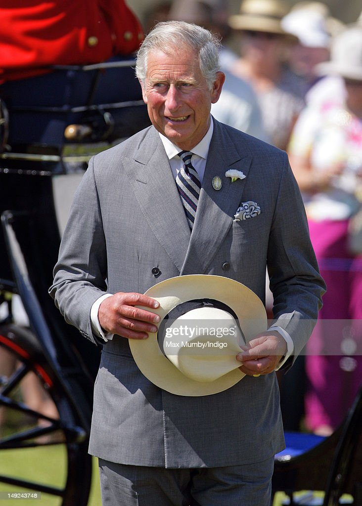 <a gi-track='captionPersonalityLinkClicked' href=/galleries/search?phrase=Prince+Charles+-+Prince+of+Wales&family=editorial&specificpeople=160180 ng-click='$event.stopPropagation()'>Prince Charles</a>, Prince of Wales tours the Sandringham Flower Show along with Camilla, Duchess of Cornwall at Sandringham on July 25, 2012 in King's Lynn, England.