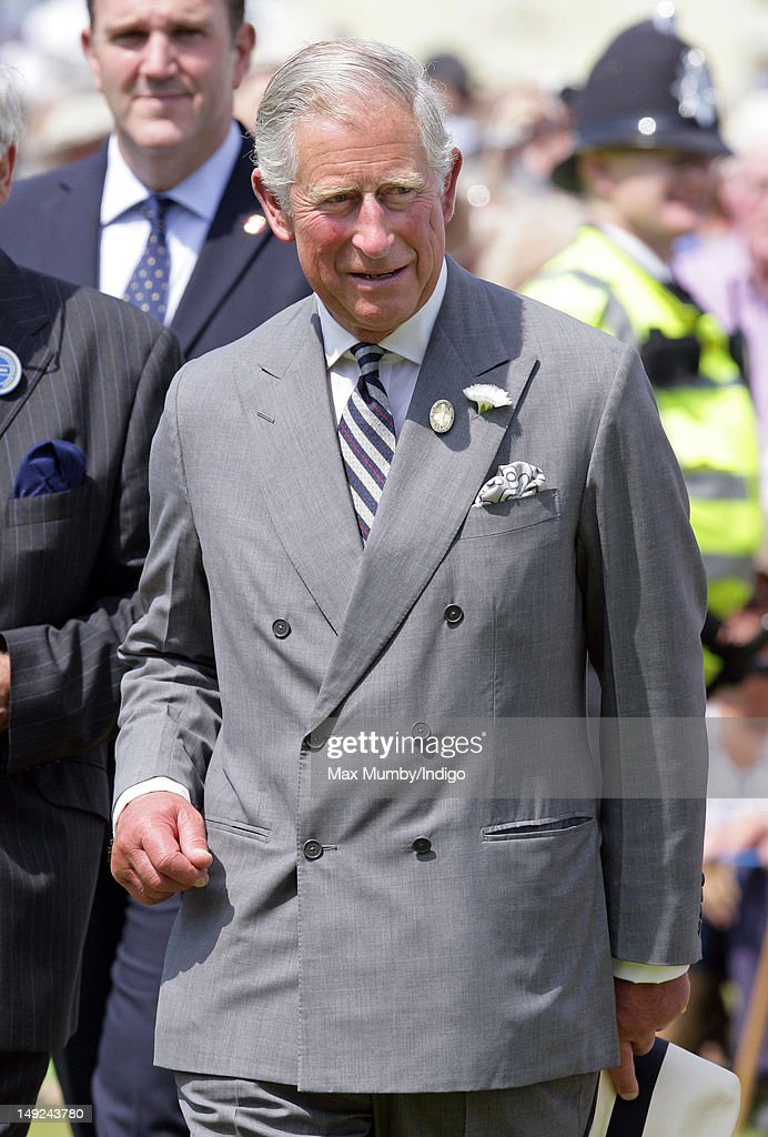 Prince Charles, Prince of Wales tours the Sandringham Flower Show along with Camilla, Duchess of Cornwall at Sandringham on July 25, 2012 in King's Lynn, England.