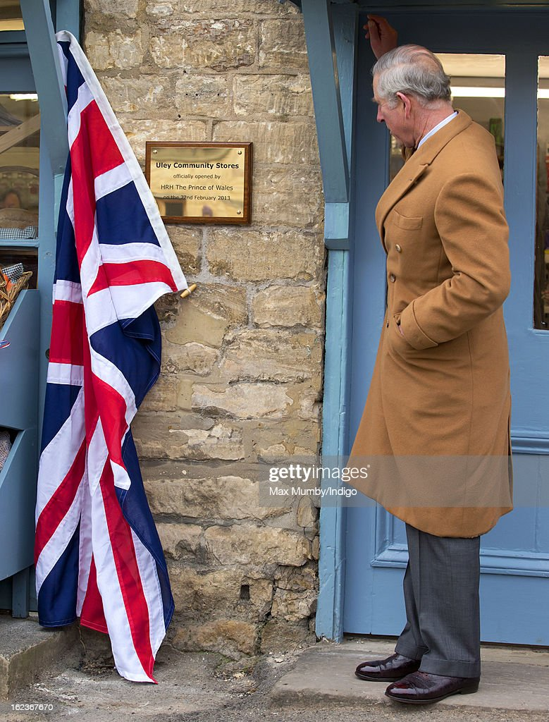 Prince Charles, Prince of Wales unveils a plaque as he visits the Uley Community Stores and Post Office whilst on a day of engagements in Gloucestershire on February 22, 2013 in Uley, Gloucestershire, England.