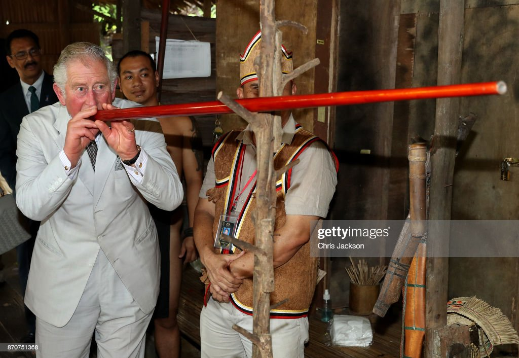 Prince Charles, Prince of Wales uses a blowgun during a visit to the Sarawak Cultural Village, where visitors are encouraged to learn through engaging with culture, on November 6, 2017 in Kuching, Sarawak, Malaysia. Prince of Wales and Camilla, Duchess of Cornwall are on a tour of Singapore, Malaysia, Brunei and India.