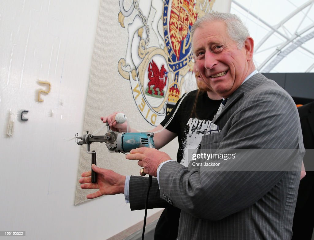 <a gi-track='captionPersonalityLinkClicked' href=/galleries/search?phrase=Prince+Charles&family=editorial&specificpeople=160180 ng-click='$event.stopPropagation()'>Prince Charles</a>, Prince of Wales uses a 'tufting gun' to work on a wool carpet featuring the royal crest at a New Zealand Sheer Brilliance event in the Cloud on November 12, 2012 in Auckland, New Zealand. The Royal couple are in New Zealand on the last leg of a Diamond Jubilee that takes in Papua New Guinea, Australia and New Zealand.
