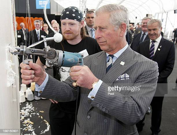 Prince Charles Of Wales Uses A Tufting Gun To Work On Wool
