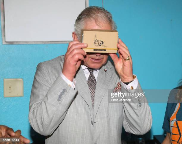 Prince Charles Prince of Wales uses google cardboard to view the damage done by the hurricane as he visits the YEP youth center on November 18 2017...