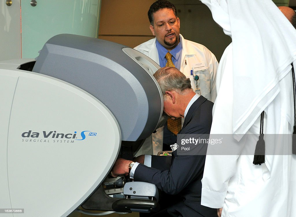 Prince Charles, Prince of Wales uses hand controllers and a 3D microscope to perform micro robotic Heart surgery, watched by Professor Abdullah Al Ansari (right) during a tour of the Science and Technology parkon the fourth day of a tour of the Middle East on March 14, 2013 in Doha, Qatar. The Royal couple are on the second leg of a tour of the Middle East taking in Qatar, Saudia Arabia and Oman.