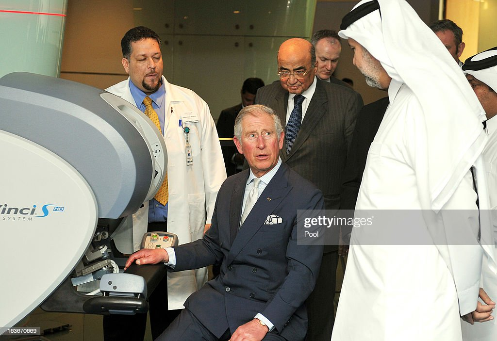 Prince Charles, Prince of Wales uses hand controllers and a 3D microscope to perform micro robotic Heart surgery, watched by Professor Abdullah Al Ansari (right) during a tour of the Science and Technology park on the fourth day of a tour of the Middle East on March 14, 2013 in Doha, Qatar. The Royal couple are on the second leg of a tour of the Middle East taking in Qatar, Saudia Arabia and Oman.