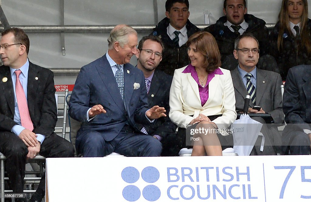 <a gi-track='captionPersonalityLinkClicked' href=/galleries/search?phrase=Prince+Charles&family=editorial&specificpeople=160180 ng-click='$event.stopPropagation()'>Prince Charles</a>, Prince of Wales, Vice Royal Patron, and Foreign Minister <a gi-track='captionPersonalityLinkClicked' href=/galleries/search?phrase=Maria+Angela+Holguin&family=editorial&specificpeople=7133255 ng-click='$event.stopPropagation()'>Maria Angela Holguin</a> view a rugby demonstration during a celebration marking the 75th Anniversary of the British Council in Colombia at Gimnasio Moderno School, on October 29, 2014 in Bogota, Colombia. The Royal Couple are on a four day visit to Colombia as part of a Royal tour to Colombia and Mexico. After fifty years of armed conflict in Colombia the theme for the visit is Peace and Reconciliation.