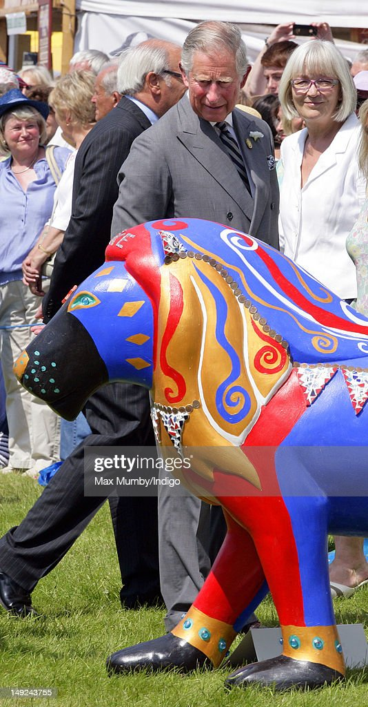 Prince Charles, Prince of Wales views a decorated model lion as he tours the Sandringham Flower Show along with Camilla, Duchess of Cornwall at Sandringham on July 25, 2012 in King's Lynn, England.