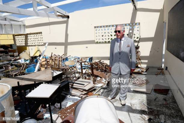 Prince Charles Prince of Wales views the devastation at the Holy Trinity School on November 17 2017 in Codrington Barbuda Prince Harry visited the...