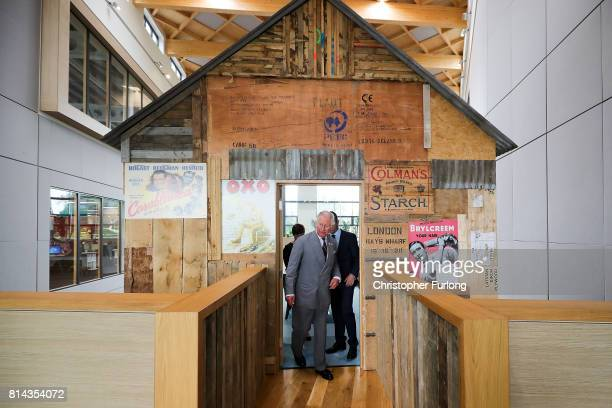 Prince Charles Prince of Wales views the tree house with Moneypenny cofounders Ed Reeves and Rachel Clacher during his annual Summer visit to Wales...