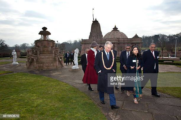 Prince Charles Prince Of Wales walks in the gardens during a tour of the Jain Temple on January 22 2015 in Potters Bar Hertfordshire England The...