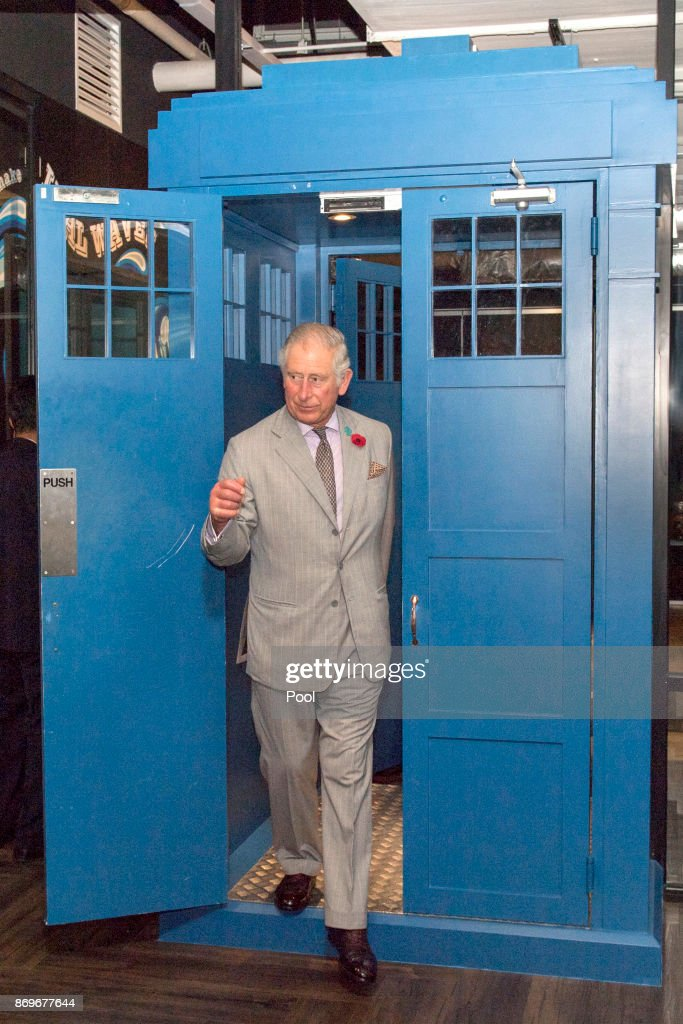 Prince Charles, Prince of Wales walks through a door in the style of Dr Who's Tardis during his visit to Worq Co-working space for Young Entrepreneurs, on November 3, 2017 in Kuala Lumpur, Malaysia.