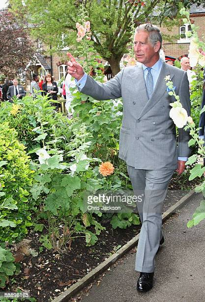 Prince Charles Prince of Wales walks through an allotment as he is taken on a tour of St Pancras Almshouses on July 8 2009 in London England The...