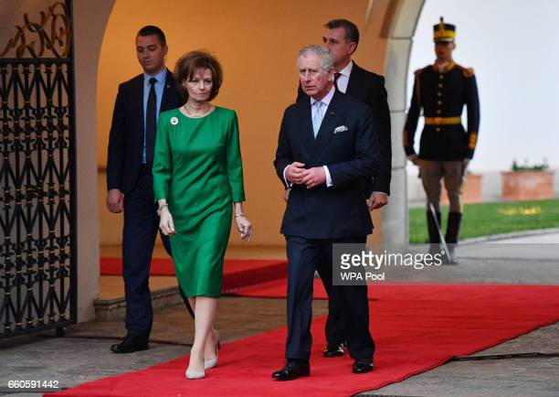 Prince Charles Prince of Wales walks with Crown Princess Margareta of Bucharest during a Tea with the Romanian Royal Family on the second day of his...
