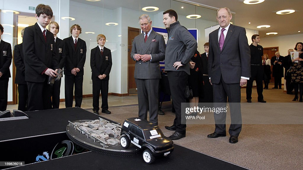 Prince Charles, Prince of Wales watches a pupil from Wilmslow High School driving a remote control car during a visit the Jaguar Land Rover Education Centre on January 21, 2013 near Wilmslow, Merseyside, England. Prince Charles is carrying out a series of engagements in the North West to celebrate British manufacturing and engineering.