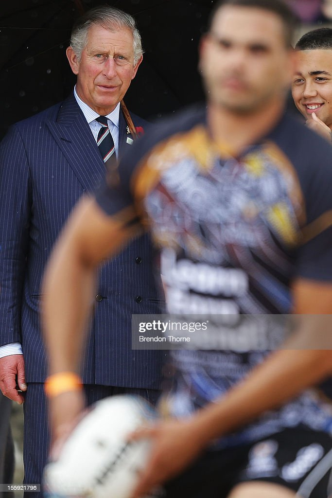 <a gi-track='captionPersonalityLinkClicked' href=/galleries/search?phrase=Prince+Charles&family=editorial&specificpeople=160180 ng-click='$event.stopPropagation()'>Prince Charles</a>, Prince of Wales watches indigenous NRL star <a gi-track='captionPersonalityLinkClicked' href=/galleries/search?phrase=Greg+Inglis&family=editorial&specificpeople=597192 ng-click='$event.stopPropagation()'>Greg Inglis</a> play Rugby League with young indigenous high school students on Bondi Beach at Bondi on November 9, 2012 in Sydney, Australia. The Royal couple are in Australia on the second leg of a Diamond Jubilee Tour taking in Papua New Guinea, Australia and New Zealand.