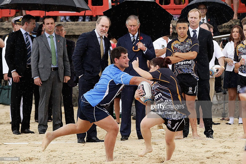 <a gi-track='captionPersonalityLinkClicked' href=/galleries/search?phrase=Prince+Charles&family=editorial&specificpeople=160180 ng-click='$event.stopPropagation()'>Prince Charles</a>, Prince of Wales watches young indigenous high school students play Rugby League on Bondi Beach at Bondi on November 9, 2012 in Sydney, Australia. The Royal couple are in Australia on the second leg of a Diamond Jubilee Tour taking in Papua New Guinea, Australia and New Zealand.