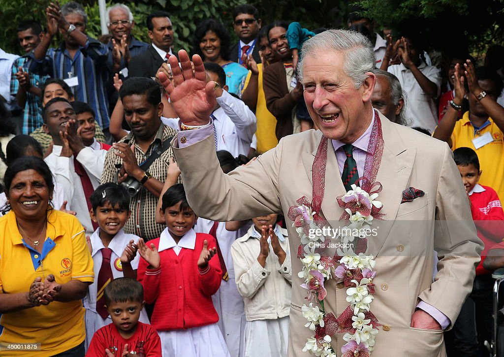 Prince Charles, Prince of Wales waves as he visits MEDCAFEP Day School on Day 3 of a visit to Sri Lanka on November 16, 2013 in Kandy, Sri Lanka. The Royal couple are visiting Sri Lanka in order to attend the 2013 Commonwealth Heads of Government Meeting. Prince Charles, representing the Queen will open the meeting.