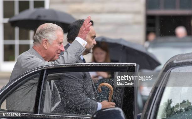 Prince Charles Prince of Wales waves as he visits the Royal Welsh Regimental Museum during The Prince of Wales' annual Summer visit to Wales on July...