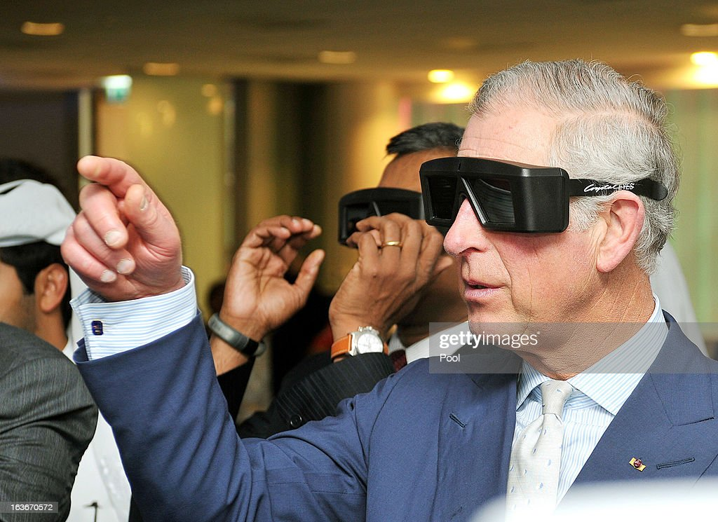 <a gi-track='captionPersonalityLinkClicked' href=/galleries/search?phrase=Prince+Charles&family=editorial&specificpeople=160180 ng-click='$event.stopPropagation()'>Prince Charles</a>, Prince of Wales wears 3D glasses as he watches micro robotic Heart surgery during a tour of the Science and Technology park on the fourth day of a tour of the Middle East on March 14, 2013 in Doha, Qatar. The Royal couple are on the second leg of a tour of the Middle East taking in Qatar, Saudia Arabia and Oman.
