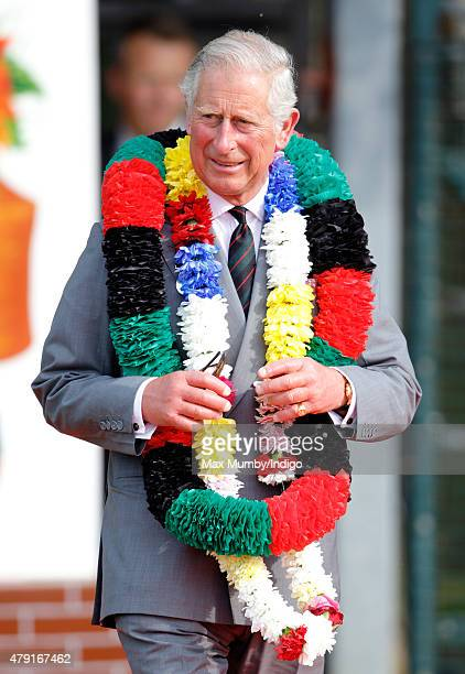 Prince Charles Prince of Wales wears a traditional garland as he visits 2nd Battalion The Royal Gurkha Rifles at Sir John Moore Barracks on July 1...
