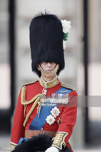 Prince Charles Prince of Wales wears uniform and a traditional bearskin hat as Colonel of the Welsh Guards attends Trooping the Colour on June 17...