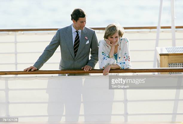 Prince Charles Prince of Wales with Diana Princess of Wales on the Royal Yacht Britannia at the start of their honeymoon cruise Her outfit is...