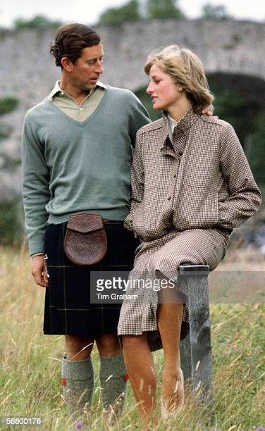 Prince Charles Prince of Wales with his arm around Princess Diana Princess of Wales as they sit on a style during their honeymoon at Balmoral in...