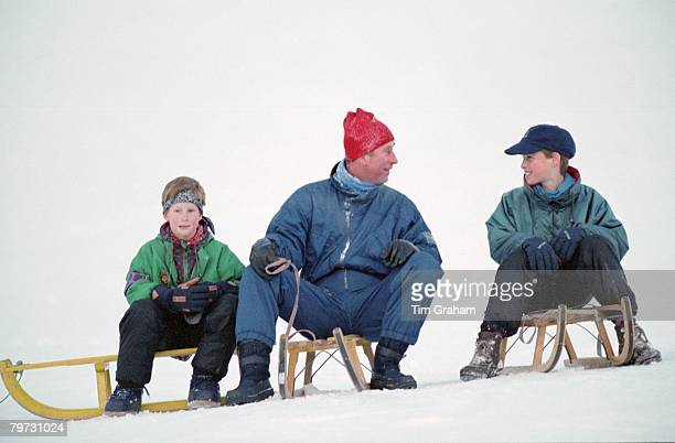 Prince Charles Prince of Wales with his sons Prince William and Prince Harry on sledges whilst on holiday in Klosters