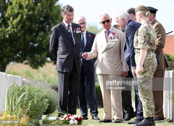 Prince Charles Prince of Wales with Vice Admiral Sir Timothy Laurence and First Minister of Wales Carwyn Jones during a visit to Artillery Wood...