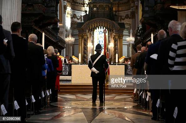 Prince Charles Prince of WalesA police officer holds a flag during the National Police Memorial Service at St Paul's Cathedral on September 25 2016...