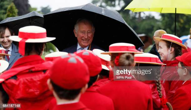 Prince Charles Prince of Walesmeets pupils from Broomfield House school during a visit to the Royal Botanic Gardens on May 17 2017 in London England...