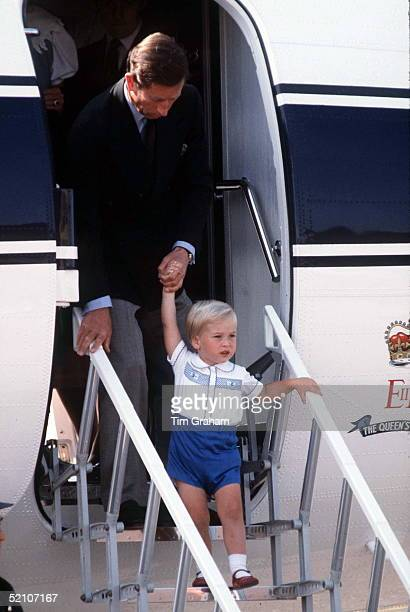 Prince Charles Prince William Disembarking A Royal Flight Plane
