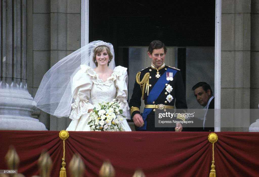 Prince Charles Princess Diana stand on the balcony of Buckingham Palace after their wedding ceremony at St Paul's Cathedral London England July 29...